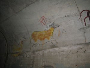 In the tunnels of Fort Point is a collection of paintings that bring the feeling of ancient cave paintings.